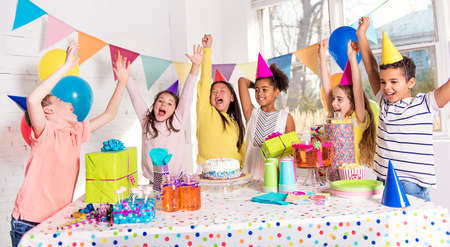 group of children at birthday party at home Stockfoto