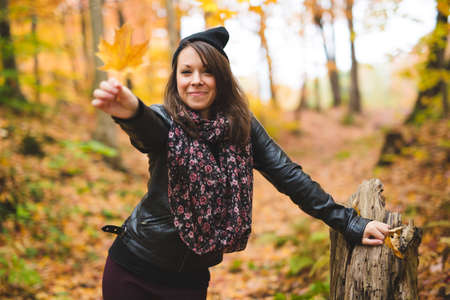 Portrait of cheerful young woman in autumn season