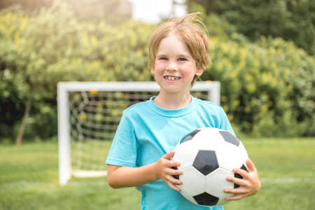 A nice Young caucassian soccer player football outside