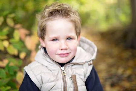 boy in autumn season in a park Stock Photo