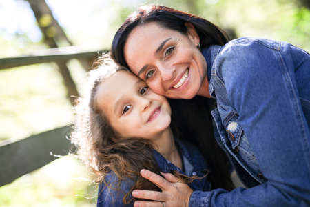 Portrait of happy mother and daughter outdoor