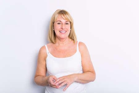 Senior casual woman style portrait, studio shot, isolated on white background Foto de archivo