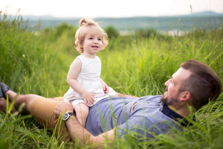 Beautiful portrait of young attractive father with daughter toddler