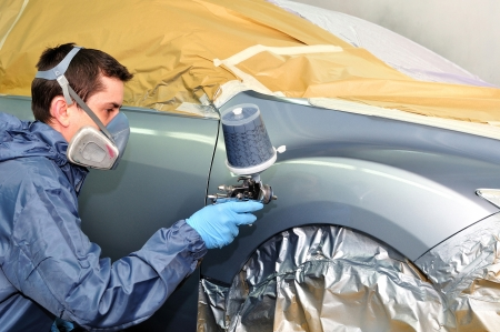 masking tape: Worker painting a car