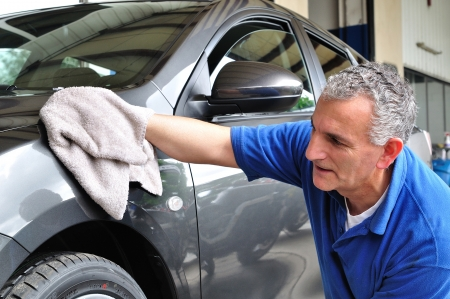 car cleaning: Man cleaning a car