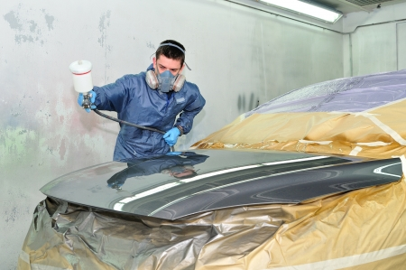 Worker painting a car  photo