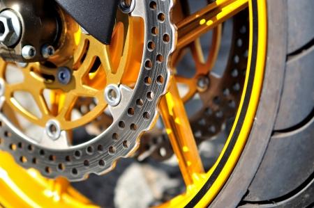 Motorcycle wheel with focus on disc brake  Standard-Bild