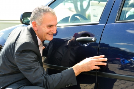 Insurance agent inspecting a car