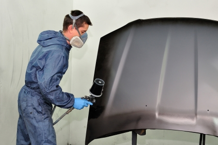Worker painting a car bonnet  photo
