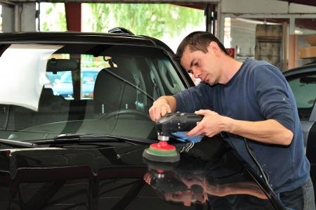 burnish: Worker polishing car bonnet  Stock Photo