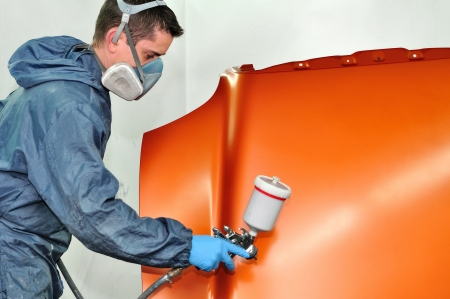 bodywork: Worker painting a car bonnet