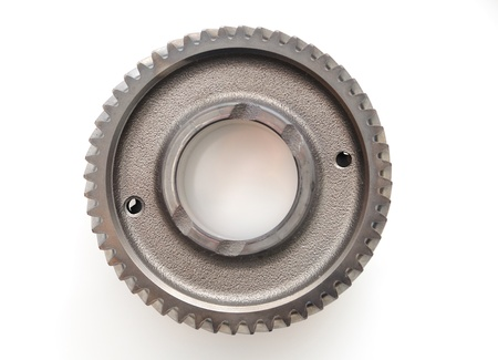 engine parts: Car gear box sprocket isolated on white background