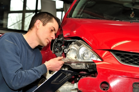 accident body: Insurance agent inspecting a car