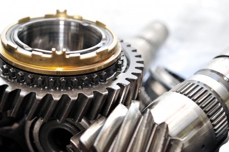axle: Transmission wheels and axle from car gearbox  Stock Photo