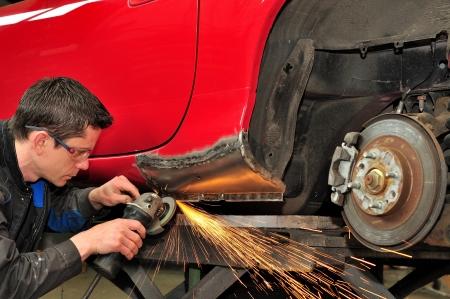 Mechanic at work  Standard-Bild