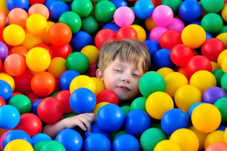 playcentre: Boy playing in ball pool