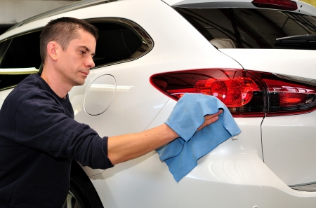 whie: Man cleaning a whie car  Stock Photo