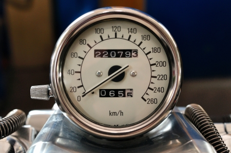 Motorcycle tachometer with chrome ring and white dial