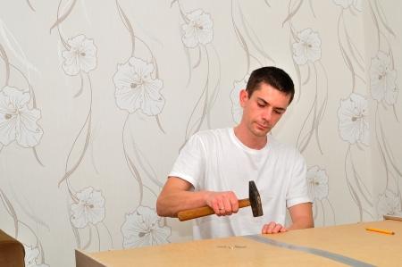Man assembling a wardrobe at home  photo