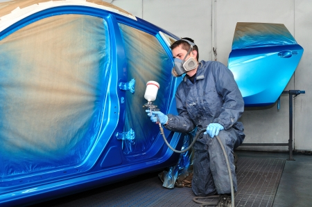 Profesional car painting in a paint booth  photo