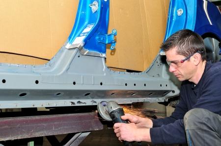 car body: Proffesional worker grinding car body