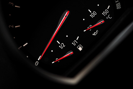 Car fuel indicator with white digits.