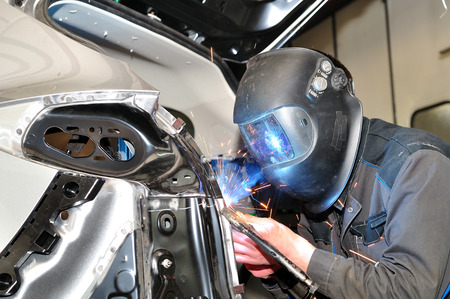 Proffesional car body repair, welding panels.