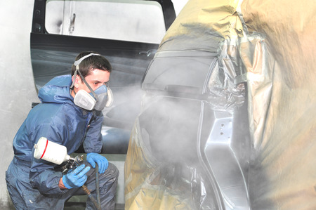 Proffesional car body repair Painting Side Panel. photo
