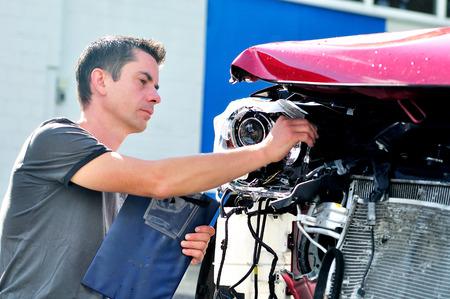 bulge: Insurance agent inspecting car damage. Stock Photo