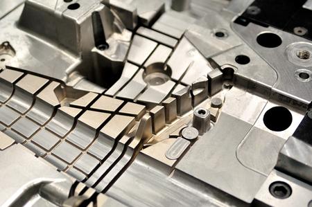 cast: Detail part of a cast machine.