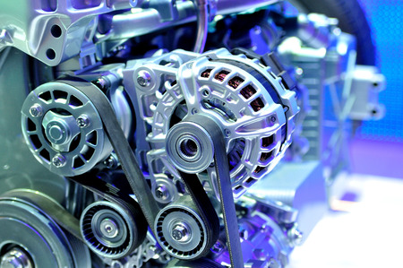 automotive parts: car alternator with drive belt.