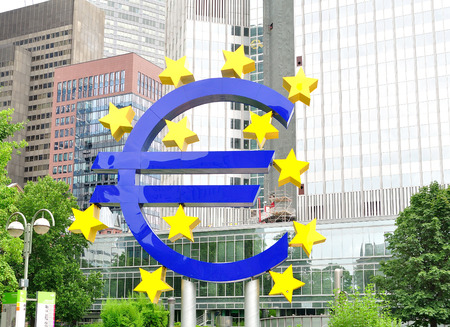 euro sign: Frankfurt, Germany - July 19, 2015: Euro sign in front of European Central Bank.