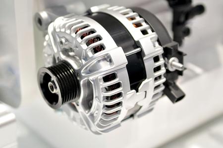 alternator: car alternator with drive wheel.