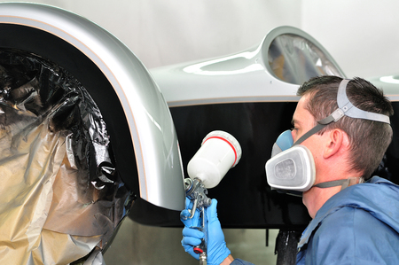 Painting stripped motorcycle side car.