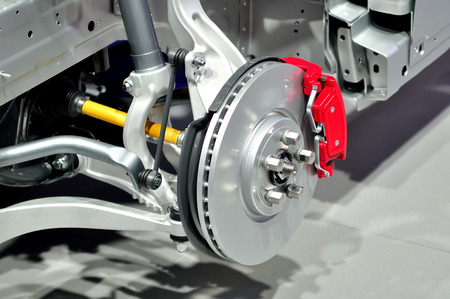 note pad: Car suspension with disc brake. Stock Photo