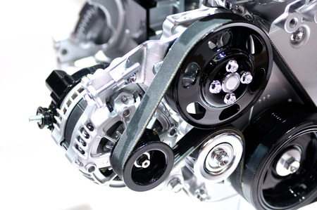 alternator: Car alternator with drive belt isolated. Stock Photo