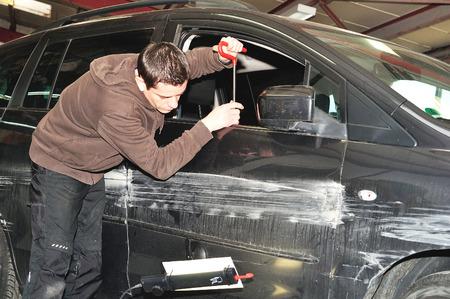dent: Car door smart repair using PDR technology. Stock Photo