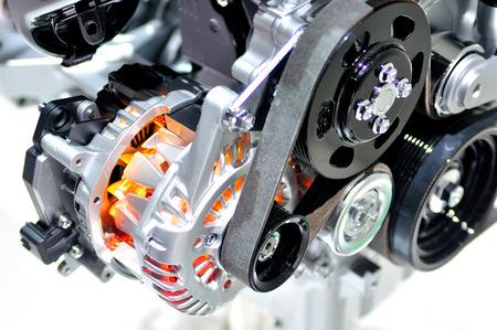 Very hot car alternator with drive belt. Imagens