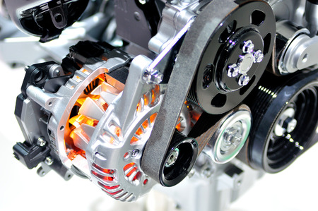 alternator: Very hot car alternator with drive belt. Stock Photo