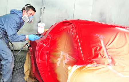 car body: Sports coupe painting red by professional.