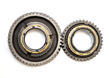 toothed: Two toothed gears isolated on white background.
