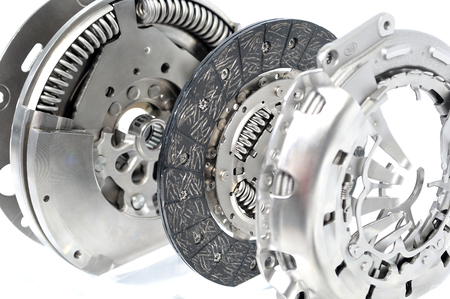 flywheel: Dual mass flywheel with clutch plate and spring isolated on white background.