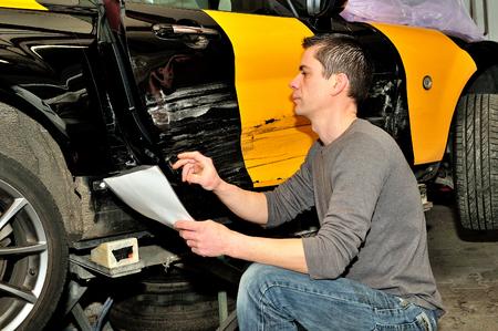 appraise: Professional car appraiser evaluate car damage.