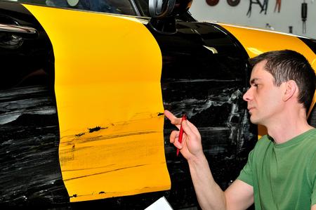 Inspecting car damage after a crash.