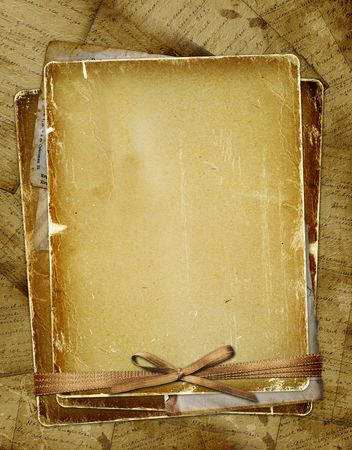 photoalbum: Old page with ribbons and bow on the abstract background