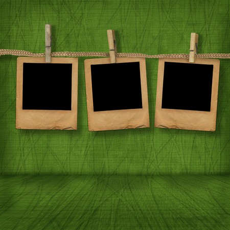 17th of march: Old photoframes are hanging in the row on the abstract background