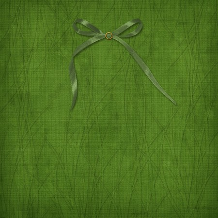 blessed: Grunge green background with bow îò the ancient ornament Stock Photo