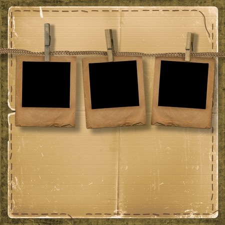 Old photoframes are hanging in the row on the abstract background