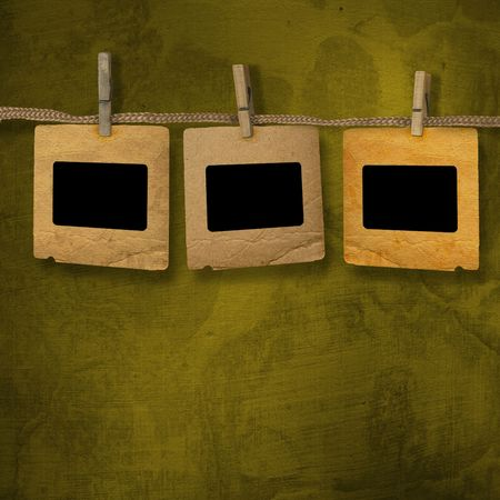Old photoframes are hanging in the row on the abstract background photo