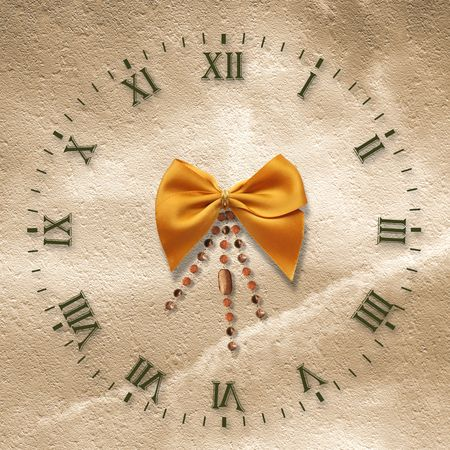 Antique clock face on the abstract background with bow photo